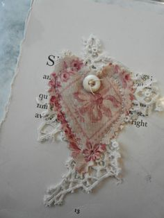 I save every little scrap of antique fabric, lace and buttons.  I was able to use old page books and the result is wonderful.  They make great Christmas, valentines, b-day cards.