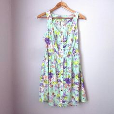 CLOSET WIDE SALE Mint floral dress Closet-wide Sale!! Tons of price drops and higher bundle discounts! Bundle and save! No holds!  Excellent condition! Fun spring and summer dress! 100% poly. Armpit to armpit measures 18 inches. Length shoulder down 33 inches.  Bundle for best deals! Hundreds of items available for discounted bundles! You can get lots of items for a low price and one shipping fee!  Follow on IG: @the.junk.drawer Mimi Chica Dresses
