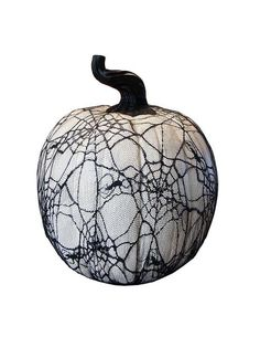 Unique white pumpkin is covered with decorative black lace featuring cob webs and spiders creating a creepy effect For indoor use only - if using outdoors place