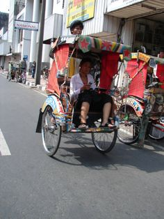 Rickshaw - a tricycle vehicle. Pay the driver and he will take you anywhere you want to go. FUN way to commute.