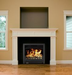 Large landscape open inset woodburning stove with large window showing a good flame picture.