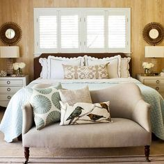 I love the neutral colors, mirrors above the side table, and couch at the foot of the bed.  The warm feel makes this space a great guest room but also a comfortable master bedroom.  The shutters above the bed gives wonderful light into the room as well.  Lastly, I really like the balance of wood grain and white.