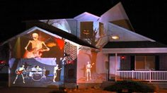 you'll a skeleton playing guitar in this live show from Halloween projector Halloween Light Show, Modern Halloween, Halloween House, Halloween Fun, Creepy Home Decor, Halloween Projector, 3d Projection Mapping, Halloween Clipart, Light Project