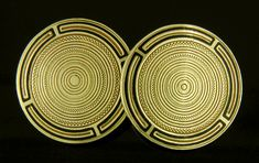 "Jazzy Art Deco cufflinks with a pattern of alternating zigzag and concentric circles surrounded by black enamel borders.  The almost hypnotic effect of these cufflinks is a nice example of the ""Op Art"" designs of the later Art Deco era.  Created by Wordley, Allsopp & Bliss in 14kt gold,  circa 1930."