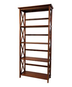 Look at this #zulilyfind! Walnut Five-Tier Montego Bookcase #zulilyfinds $72.99 With a rich finish accentuating the tones of the solid wood construction, this bookcase is sure to look elegant wherever it's placed. It features five spacious shelves for storing books, media, magazines and more.  29.5'' W x 63'' H x 12'' D 100% wood Assembly required