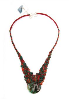This is a one of a kind creation.This necklace is made out of macrame knots in thin linen threads combined with a marble like Murano glass bead bought directly in Venice and it has also small glass seed beads in green and red.Neck width: 41,5 cm - 16,4 inch Necklace Length (from beginning of neck): 10 cm - 4 inch it's closure is made out of a handmade silver clasp.