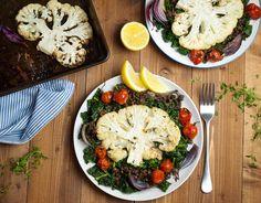 Roast Cauliflower Steaks with Kale & Lentils Recipe Main Dishes with cauliflower, kale, purple onion, tomatoes on the vine, puy lentils, olive oil, lemon, garlic, thyme, sea salt, freshly ground black pepper, lemon wedges