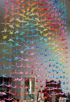 Rainbow paper cranes  http://fuckyeahpapercranes.tumblr.com/
