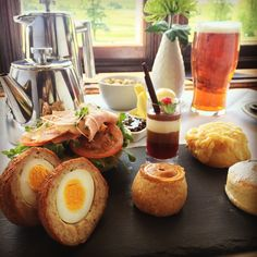 Gentleman's afternoon tea. A twist on the British classic. Including a homemade scotch egg, pork pie, Cheese and Pancetta scone, a fruit scone, a home cooked Northumbrian Ham, tomato and rocket sandwich with a raspberry and chocolate trifle.
