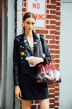 Adorned with pins...cropped leather biker jacket worn with mini skirt & accessorised with transparent red doctors bag - very 80s! 😻 || Saved by Gabby Fincham ||