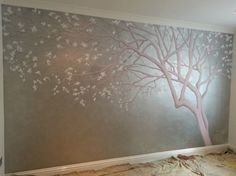 This pretty mural was painted in a little girls nursery. The wall was spray painted silver and the tree trunk was painted in a pale pink over the top, with white blossom detailing. This design is very popular, due to its simple elegance and how it can be delicately adjusted to fit any space.