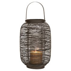 Cast a warm glow in your sunroom or entryway with this metal wire candle lantern, showcasing an organic silhouette and curving top handle. ...