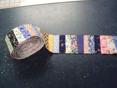 String Piecing on adding machine paper ~ I'm goin' through my scrap box! I've been meaning to do this for years!