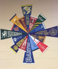 College pennant pinwheel in an AVID classroom. School Counselor Office, Middle School Counseling, College Counseling, Future Classroom, Art Classroom, Classroom Organization, Counseling Bulletin Boards, School Bulletin Boards, College Advisor
