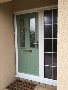 Perfecta Windows - Weston Super Mare Composite Door in chartwell green with white frames and side panel. Finished with stippolyte privacy glass and chrome hardware Purple Front Doors, Best Front Doors, Glass Front Door, Glass Door, Composite Front Door, White Frames, Privacy Glass, Double Glazed Window, Norfolk