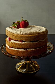 Poppy seed cake with mascarpone icing and strawberries