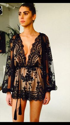 Black Lace Floral Sequin Playsuit via UrbanChicOutlet. Click on the image to see…