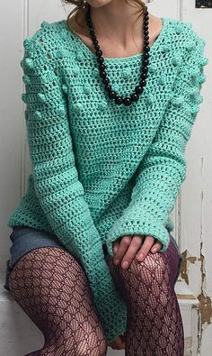 "The ""Make a Mint"" sweater from the cover of Simply Crochet #22 is right on trend. Replace the bobbles with pompoms and you've made yourself a sweater from the Libertine SS15 NYFW show."