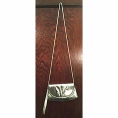 Small silver purse Tiny silver shoulder purse. Can also be a wristlet. Used once for a homecoming! Bags Shoulder Bags