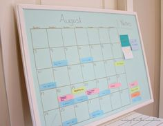 See how I organized my life with this DIY Aqua & Gold Chalkboard Calendar!