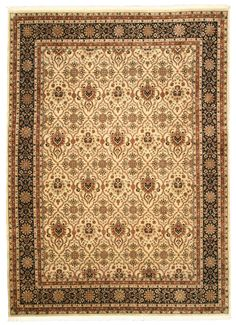 This beautiful handknotted Varamin rug with a classic allover panel design and wool pile is a perfect fit to any décor. - Handknotted construction. - Primary materials: Wool - Latex: No - Pile height: