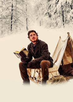Richard Madden. Scottish accent? Curly hair? Reading while camping? Yes to all.