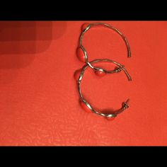 Orange hoop earrings These are just super fun earrings to add to your outfit. They are silver with orange. Jewelry Earrings