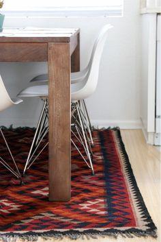 kilim rug, wood table, eiffel chairs