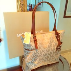Michael Kors Jet Set Zip Tote NEW!!!! Authentic from Michael Kors. Zip top tote. Signature canvas, handles in saddle (leather). Spacious and chic. ✅New with tag attached      No trades                                                              ✈️Same day/next day shipping                             Thank you Michael Kors Bags Totes