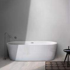 Super thin profile acrylic freestanding bathtub like popular Coco tub lend a sophisticated edge to modern + transitional bathrooms. Pair with INOX stainless steel tub filler for added sophistication!   #design #home #blu #event #fall #furniture #luxury #interior #design #modern #decor #minimal #minimalist #interiordesign #love #designhound #collection #bathtub #blubathworks