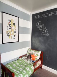 The article is about painting the stripes but I love the chalkboard wall. That'd be awesome for a kids room.