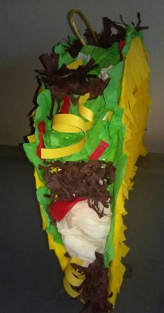 Here comes the Fiesta! Add fun to your Party with this awesome Taco Pinata. Fill it with candy, toys confetti or wherever you want. Measures: 19 wide