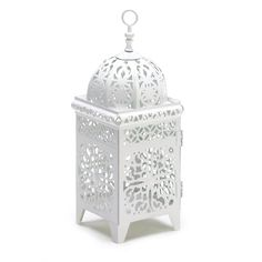 Bright white and intricate floral filigree add fresh appeal to this birdcage lantern! As candlelight shines through the cutout panels in a kaleidoscope display your porch or patio comes alive with jub