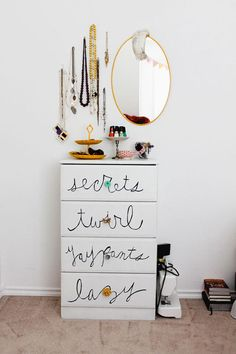 write one dresser + jewelry hanging from wall