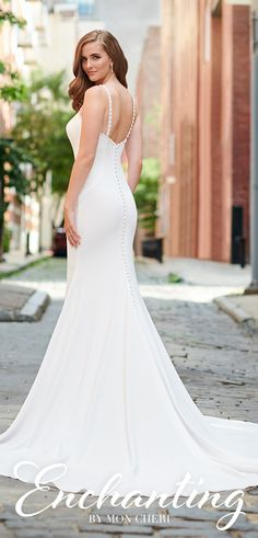 Sleeveless crepe trumpet bridal gown features lace and pearl trimmed bateau neckline, princess seamed bodice, covered buttons along zipper back to hem, chapel train. Simple Elegant Wedding Dress, Fit And Flare Wedding Dress, Classic Wedding Dress, Tea Length Wedding Dress, Country Wedding Dresses, Lace Mermaid Wedding Dress, Black Wedding Dresses, Wedding Dresses Plus Size, Cheap Wedding Dress
