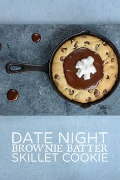 A chocolate chip skillet cookie drenched in brownie batter for two-- a perfect date night indulgence.