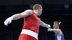 Germany's Enrico Kolling (L) congratulates Algeria's Abdelhafid Benchabla after Benchabla won their Men's Light Heavy (81kg) Round of 16 boxing match during the London 2012 Olympic Games August 4, 2012.   REUTERS/Murad Sezer