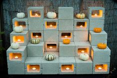 Cinderblock pumpkin display for the garden. Could be softened with succulent bowls and solar lighting.