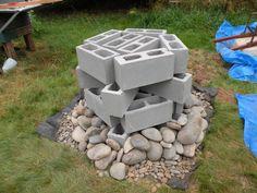 Cinder block base with river rocks/ cob oven