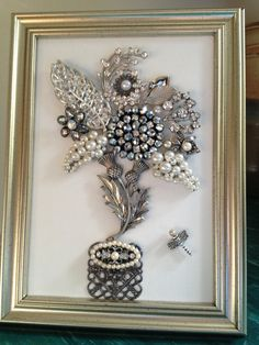 This beautiful picture handcrafted with much TLC, consists of vintage and new jewelry along with rhinestones and pearls all fashioned into a very eye