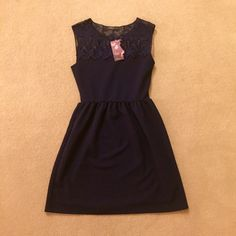 """NWT✨Navy Blue A-Line Dress New with tags, bought this for graduation but never wore it (did graduate though!). Has the most beautiful neck and shoulder detailing that makes it look like a strapless dress with a little extra something. True to size small. Falls at natural waist and about 3-4"""" above my knee (I'm 5'5""""). May end up keeping this for spring weddings if it does not sell. No PayPal, no trades, offers via offer button only! Francesca's Collections Dresses"""