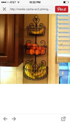 I love this fruit basket idea. I'm not sure it would work in my kitchen, but cute.