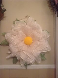 Flower wreath I made using poly burlap mesh which is more durable than the paper mesh.