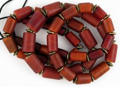 Trade Beads | Strand of Venetian Cornaline d'Aleppo ~ yellow core ~ beads, separated by old African brass spacers  | 410$ ~ 45 beads.
