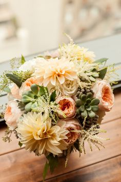 Fall Rustic Wedding at Prairie Productions in Chicago - Dawn E Roscoe Photography.  {Bridal bouquet with cafe au lait dahlias, succulents, garden roses, astilbe. Flowers by Pollen. pollenfloraldesign.com}