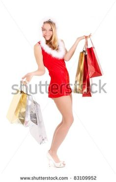 happy young woman in santa suit carrying shopping bags - stock photo