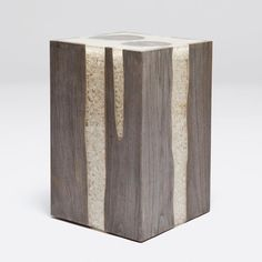 Acrylic+resin+is+combined+with+teak+to+make+this+versatile+stool+or+accent+table.+The+resin+is+filled+with+white+river+stones.+A+fun+piece+that+is+both+organic+and+modern! *Natural+variation+to+be+expected+in+each+product.