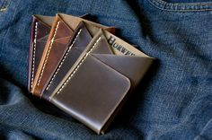 $45.  Every guy needs a new wallet.  Made from one piece of leather, this three pocket minimalist wallet is designed to hold 6 cards (more when stretched) while the front pocket securely holds folded cash. The wallets are hand stitched with waxed Irish linen thread and made with 4 oz. Horween Chromexcel (Root, Brown, Coffee Bean, Olive Brown, and Dark Cherry) and Horween Derby (Mesa).   The leather has a striking pull-up effect which lightens in areas where pressure is applied.