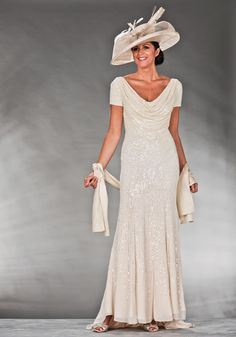 Mother Of The Bride / Groom Outfit: Long cream sequinned dress with cap sleeves and a cowl neck. This outfit has a matching stole.