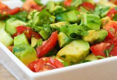 Salad from avocado, tomato and onions.